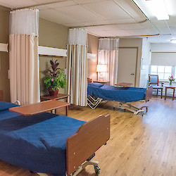 Shared bedroom with matching blue bedspreads at 60 West facility