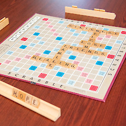 "Scrabble board with ""Hope"", ""Healing"", ""Family"", ""Friends"", ""Love"", ""Welcome"", and ""Sixty West"" all written with scrabble pieces"