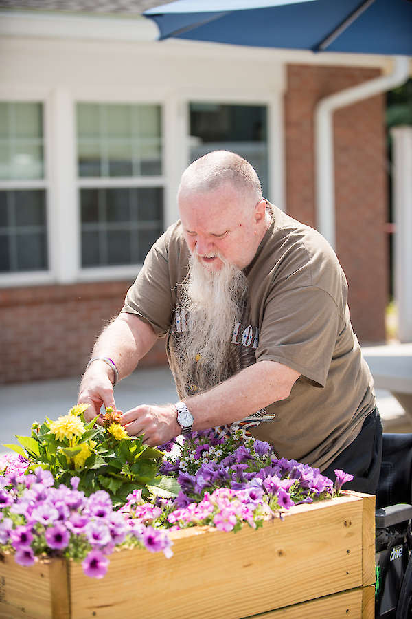 Amputee, Resident working in garden, gardening, flowers, activities, recreation, 60 West in Rocky Hill, CT